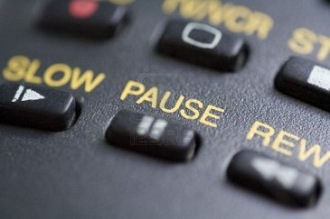 3080279-a-close-up-of-the-pause-button-on-a-remote-control